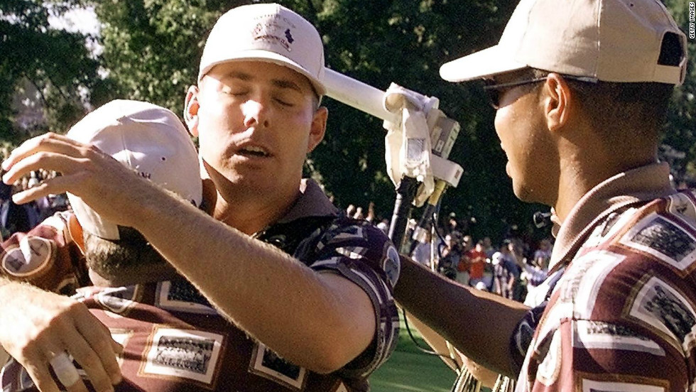 Justin Leonard is hugged by his teammates after beating Jose Maria Olazabal at the infamous match at Brookline in 1999. Olazabal had yet to make his putt to keep their singles clash alive when the U.S. team dashed onto the 17th green.