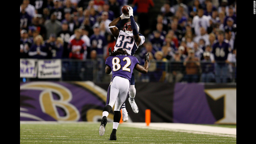Devin McCourty of the Patriots breaks up a pass intended for the Torrey Smith of the Ravens.