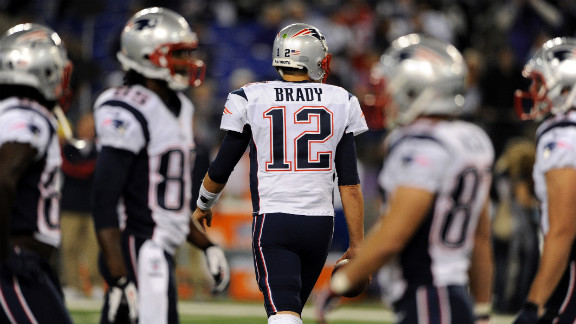 Patriots quarterback Tom Brady takes the field for Sunday night