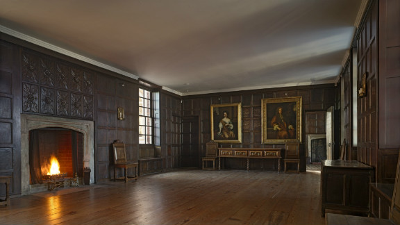 One of the first Tudor homes to be made from brick, many of its original features -- including a vast stone fireplace and a wall of intricately carved dark wood panels -- remain to this day.