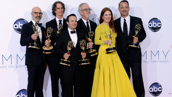 """From left, producer Steven Shareshian, director Jay Roach, writer Danny Strong, producer Gary Goetzman, actress Julianne Moore and producer Tom Hanks show off their awards in the press room for """"Game Change,"""" the HBO drama about Sarah Palin and the 2008 election, which won honors for the outstanding miniseries or TV movie. The team also took home Emmys for outstanding casting, outstanding writing, outstanding director for Roach and outstanding actress for Moore in a miniseries or TV movie."""