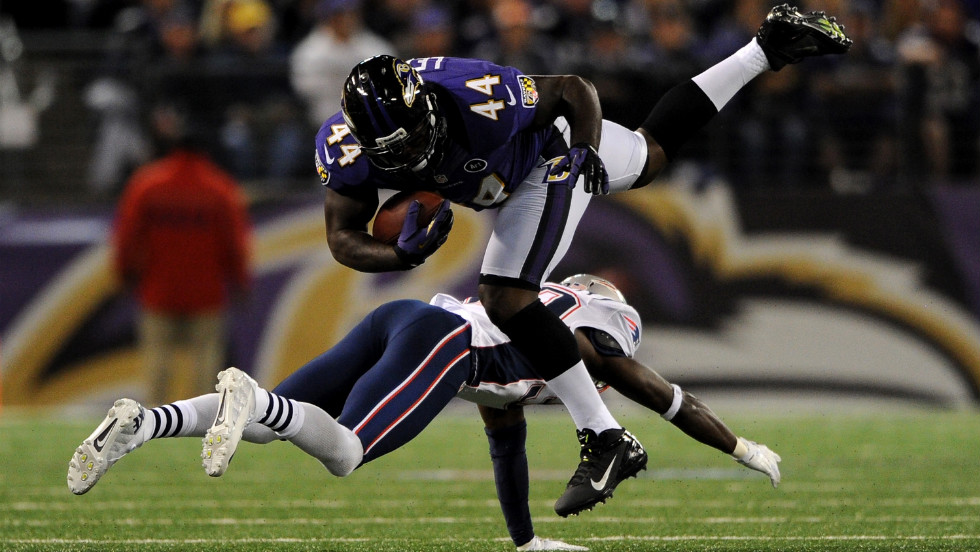 Vonta Leach of the Baltimore Ravens moves the ball for a seven-yard gain against the New England Patriots on Sunday.