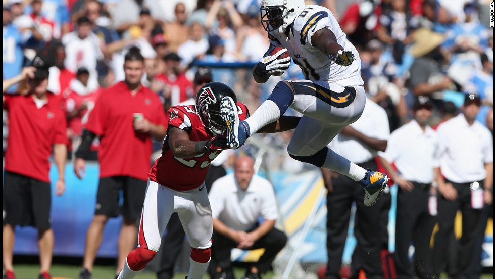 Tight end Randy McMichael of the San Diego Chargers leaps in front of Dominique Franks of the Atlanta Falcons on Sunday in San Diego. The Falcons defeated the Chargers 27-3.