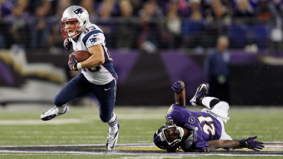Wes Welker of the New England Patriots runs with the ball after catching a pass in front of Lardarius Webb of the Baltimore Ravens in Baltimore on Sunday, September 23. The Ravens won 31-30.