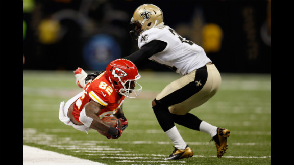Dwayne Bowe of the Kansas City Chiefs is pushed out of bounds by Patrick Robinson of the New Orleans Saints on Sunday in New Orleans. The Chiefs defeated the Saints 27-24 in overtime.