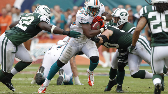 Daniel Thomas of the Miami Dolphins runs with the ball during Sunday