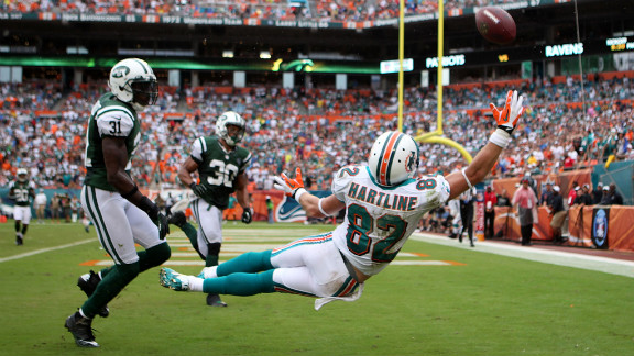 Brian Hartline of the Dolphins fails to make a catch against the Jets.