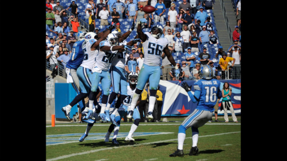 No. 56 Akeem Ayers of the Titans bats down a hail mary pass intended for the Lions