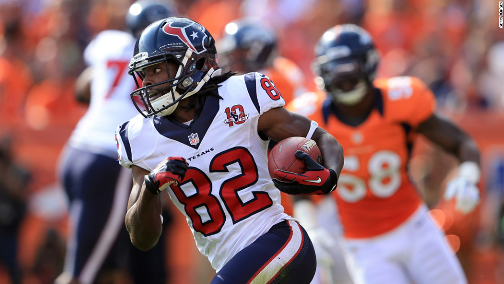 Keshawn Martin of the Houston Texans runs the ball against the Denver Broncos.