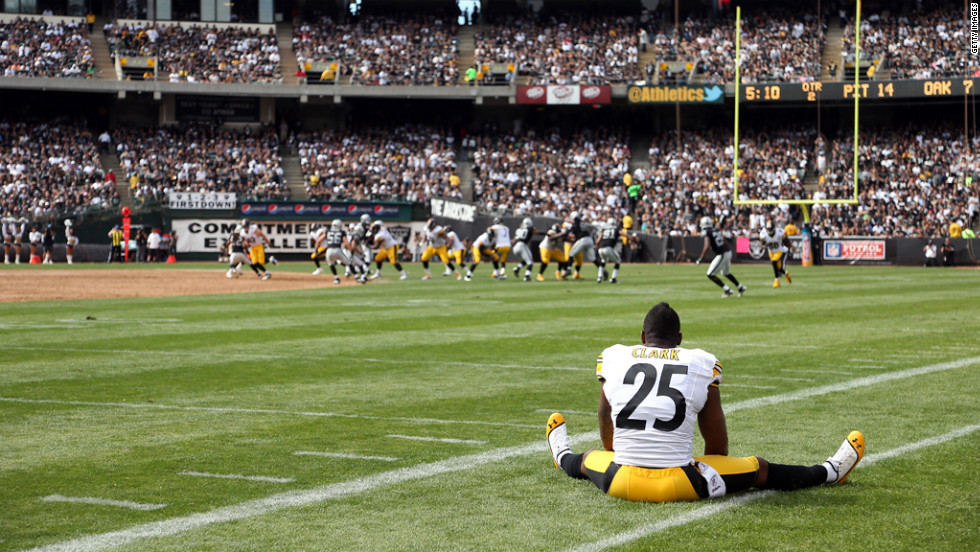 Ryan Clark of the Pittsburgh Steelers watches Sunday's game against the Oakland Raiders from the sidelines in Oakland.