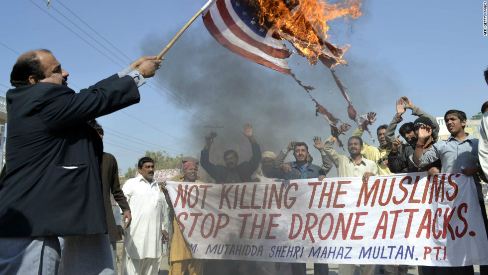 A Pakistani Man Burns An American Flag During Protest Against US Drone Attacks In Multan