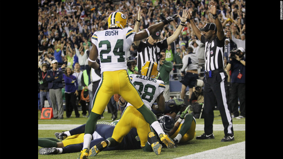 "The play was reviewed on video but was ruled a touchdown. <a href=""http://www.cnn.com/2012/09/20/football/gallery/nfl-week-3/index.html"">See the best of NFL Week 3</a>."