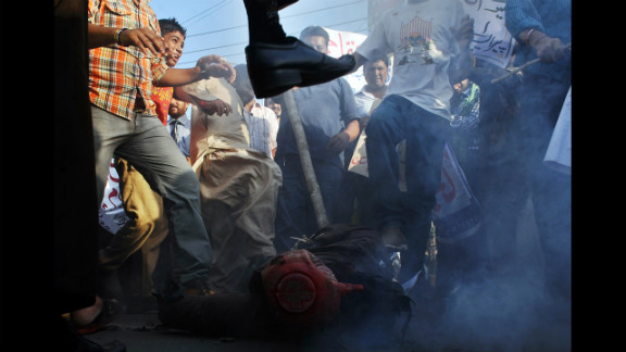 Pakistani demonstrators beat an effigy of Florida pastor Terry Jones during a protest against an anti-Islam film in Lahore on Monday, September 24. More than 50 people have died around the world in violence linked to protests against the low-budget movie, which mocks Islam and the Prophet Mohammed, since the first demonstrations erupted on September 11. See more of CNN