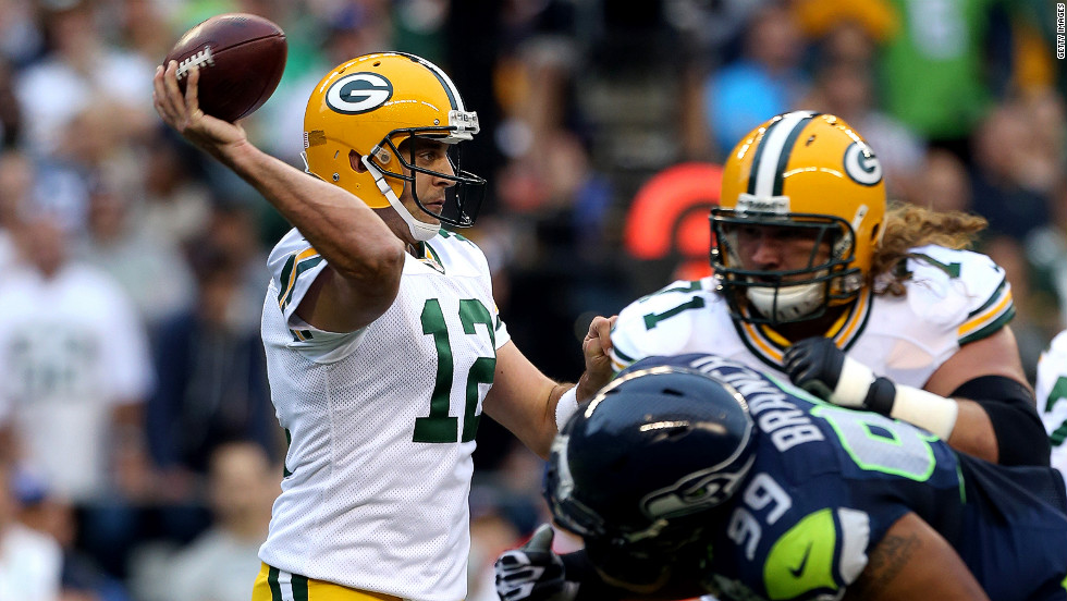 Packers quarterback Aaron Rodgers fires a pass on Monday.