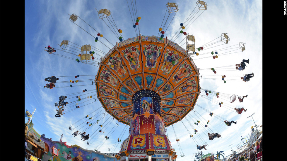 A colorful swing ride turns on Tuesday, the fourth day of the festival.