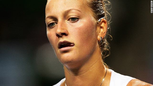 A dejected Petra Kvitova slides to defeat against unseeded Croatian Petra Martic in Tokyo.