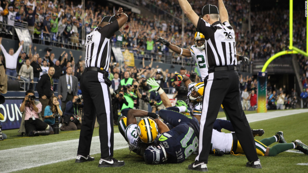 "Officials in the end zone give different signals on the final play of the Green Bay-Seattle game on Monday night. The Seahawks beat the Packers 14-12 on a controversial call in the end zone on the final play at CenturyLink Field in Seattle. Check out the action from Week 3 of the 2012 National Football League season. <a href=""http://www.cnn.com/2012/09/13/football/gallery/nfl-week-2/index.html"">Look back at the best of Week 2 </a>and <a href=""http://www.cnn.com/SPECIALS/world/photography/index.html"">see more of CNN's best photography</a>."