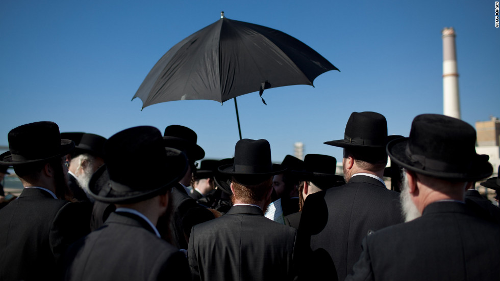 Ultra-Orthodox Jews pray as they perform the Tashlich ritual on Tuesday.