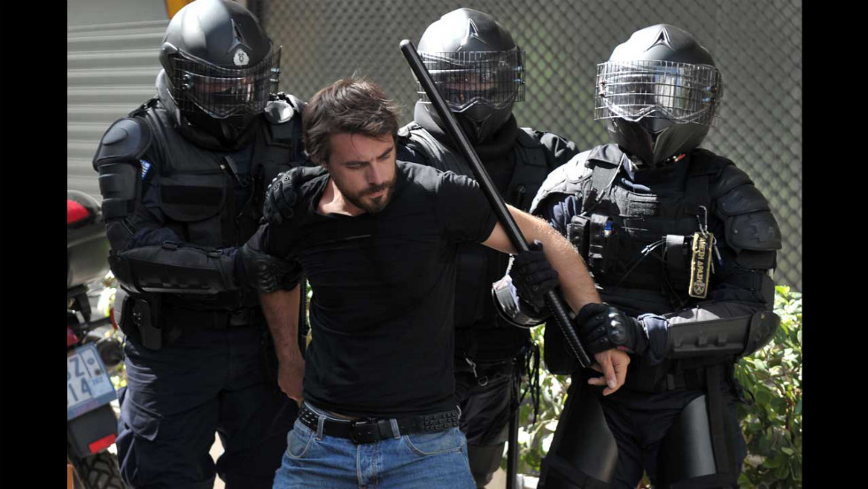 Police arrest a demonstrator during the protest march on Wednesday.