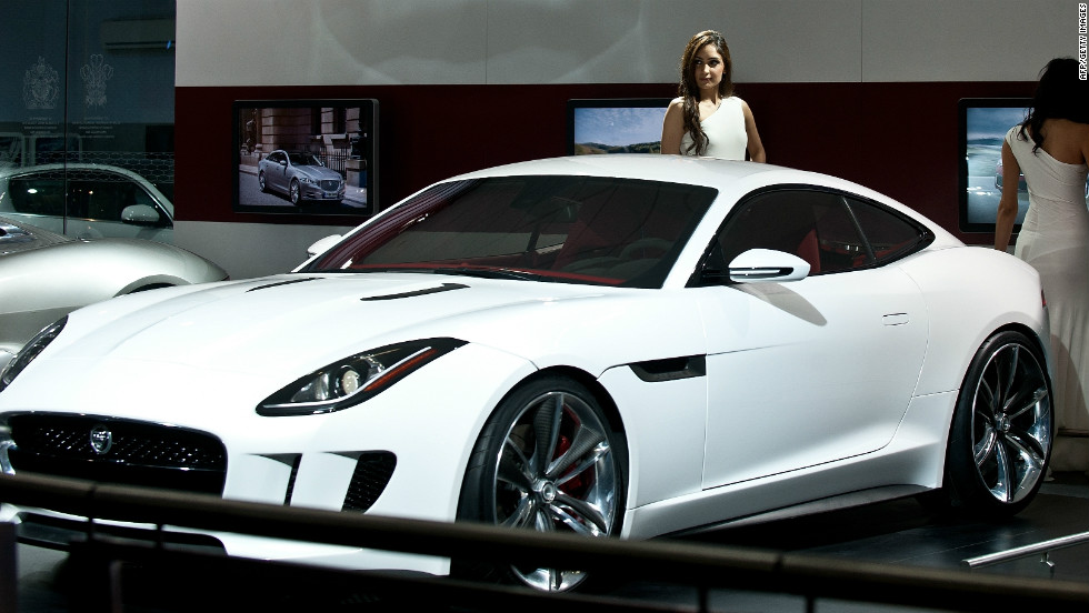 Marvelous A Model With The Jaguar CX16 Concept Car At The 2012 India Auto Expo In New