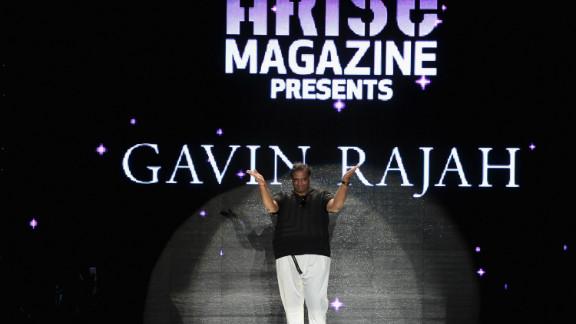 South African designer Gavin Rajah walks the runway at the Lincoln Center.