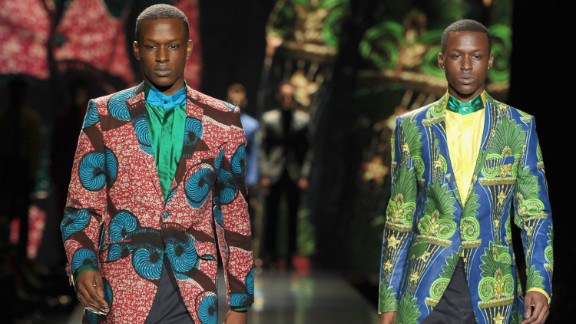 """Ozwald Boateng's collections included """"somber black suiting, casual sand and salmon linen shorts and blazers and some riotously colourful shirts and trousers made from Vlisco wax prints,"""" according to Jennings."""