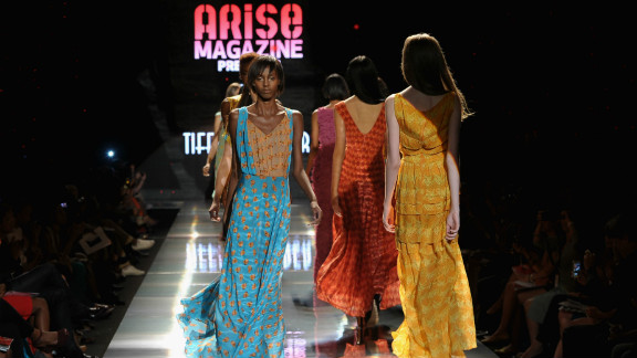 """Folake Folarin-Coker's creations for Tiffany Amber """"offered up floaty resort-wear with decadent 1970s overtones,"""" according to Jennings. """"Entitled The Rhythms Of Africa, jewel-coloured silks were hand printed with drum motifs and formed waist-cinching maxi dresses, jumpsuits and rompers."""""""