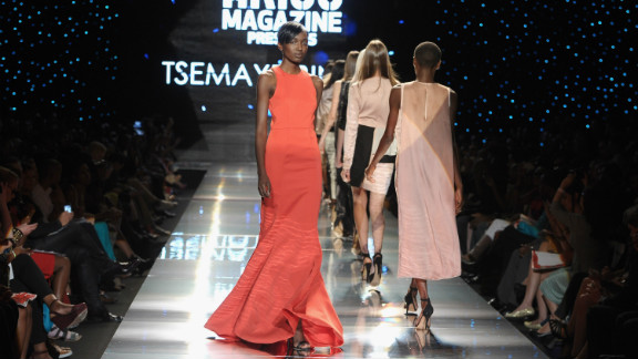 """Tsemaye Binite's show was dominated by """"marl grey jersey tracksuits with silver embossed branding, leather bomber jackets worn with denim shorts, flesh-toned panelled illusion dresses and a floor-sweeping, blood-red evening gown,"""" Jennings said."""