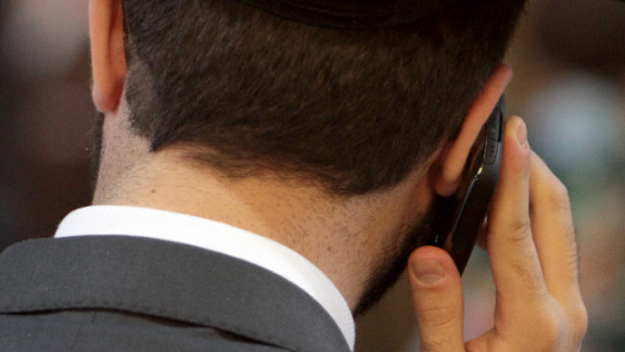 A man  talks on a mobile phone in Cologne, Germany.
