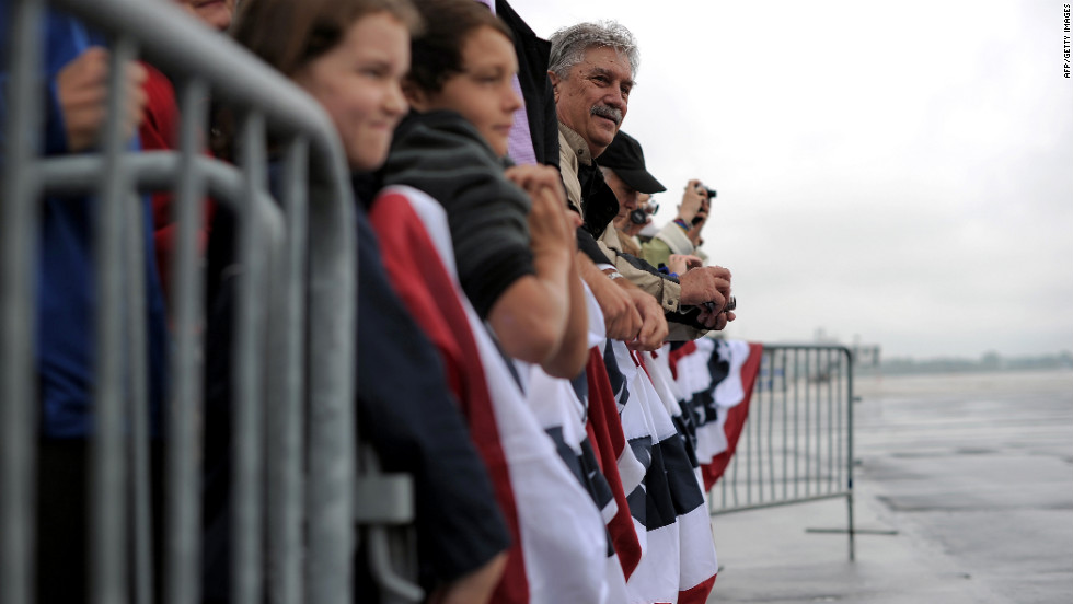 Supporters wait to see Obama on Wednesday at Toledo Express Airport in Bowling Green, Ohio. Air For One aborted an initial landing attempt in Ohio due to weather conditions.