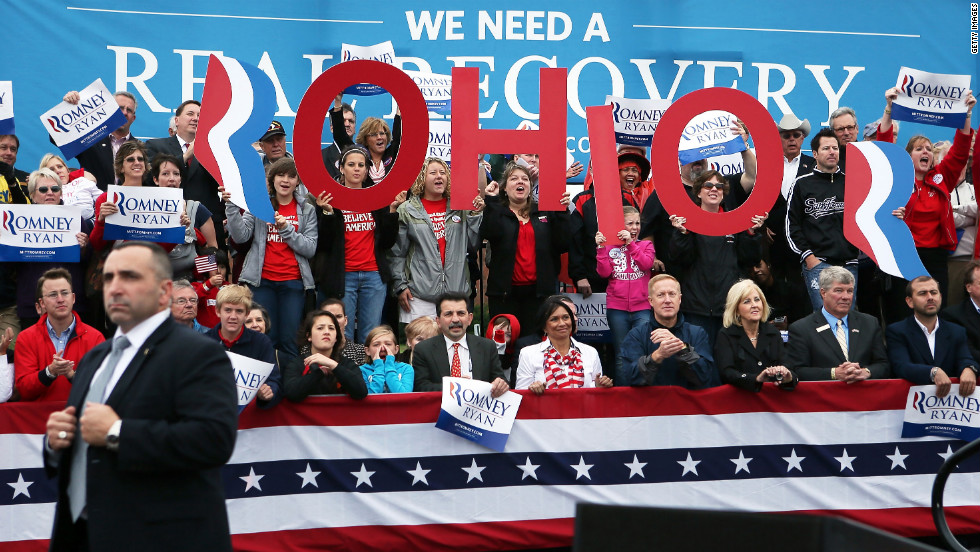 Supporters cheer during a Republican campaign rally Tuesday with Romney and his running mate, Paul Ryan, at Dayton International Airport in Vandalia, Ohio.