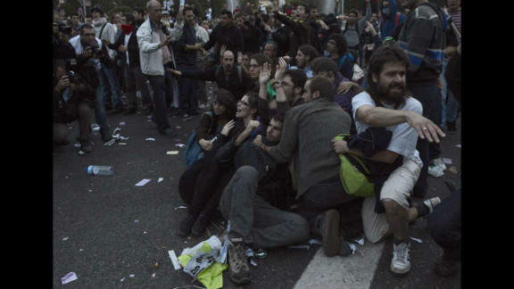Protesters shout at police during the demonstration. More than 20 people among a crowd of 6,000 were arrested, police said.