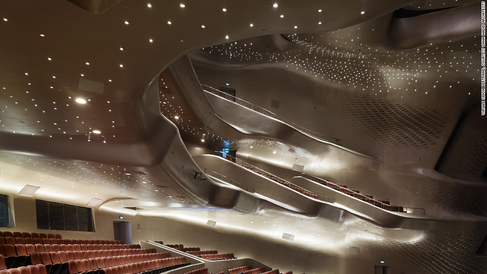 "Another riverside project, the <a href=""http://www.zaha-hadid.com/architecture/guangzhou-opera-house/?doing_wp_cron"">Guangzhou Opera House in China</a>, completed in 2010, has smooth lines which Hadid compares to ""pebbles in a stream smoothed by erosion."""