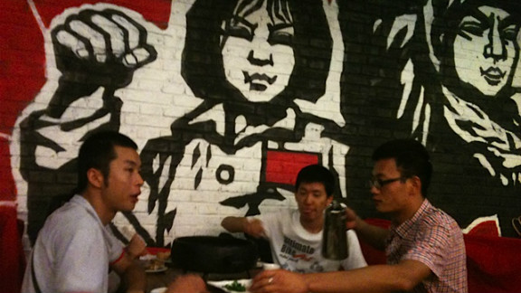 """Patrons at a Cultural Revolution-themed eatery gather for snack and """"red"""" entertainment."""