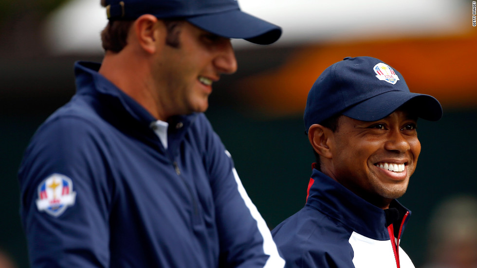 Dustin Johnson, left, and Tiger Woods of the United States laugh during a practice round Thursday.