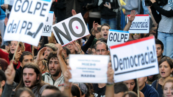 Protesters take part in a demonstration organized by Spain
