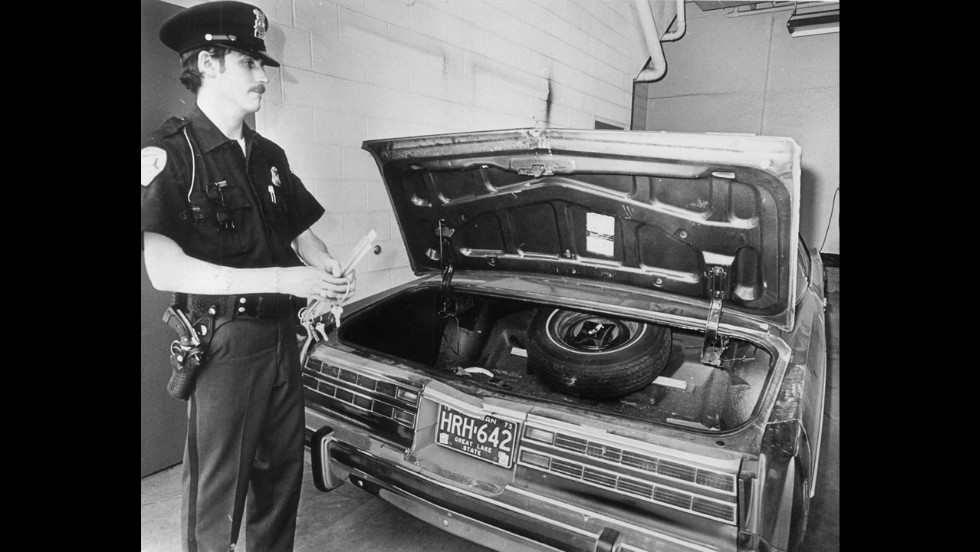 A Bloomfield Township, Michigan, police officer stands beside Hoffa's car after the former labor leader's disappearance in July 1975. Hoffa was last seen at a restaurant in suburban Detroit on July 30, 1975.