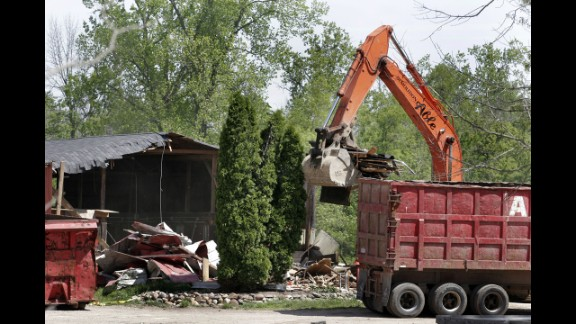 Demolition workers tear down a horse barn for the FBI in 2006 in a search for Hoffa's remains in Milford, Michigan. The FBI had received a tip that Hoffa was buried on the farm.