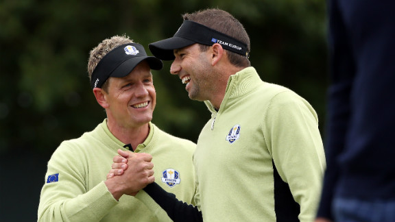 Luke Donald and Sergio Garcia of Europe celebrate on the fifth green on Friday.