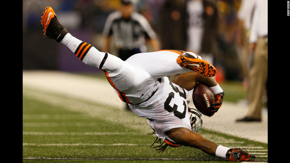 Running back Trent Richardson of the Cleveland Browns flips upside down during a run against the Baltimore Ravens.