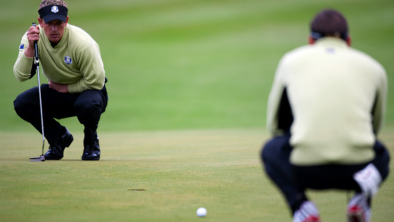 Luke Donald of England, left, and Sergio Garcia of Spain look over their putt on the sixth hole Friday.