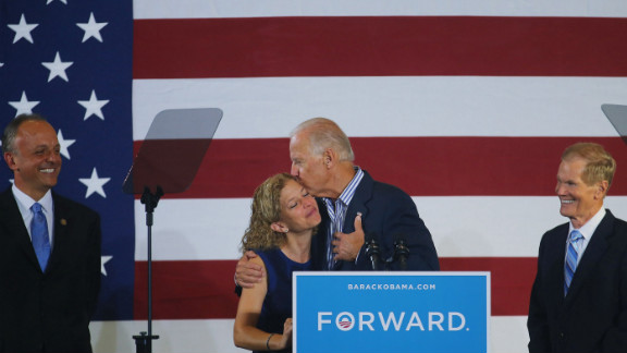 Vice President Joe Biden hugs U.S. Rep. Debbie Wasserman Schultz, chairwoman of the Democratic National Committee, as he arrives for a campaign event Friday in Boca Raton, Florida.