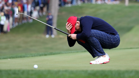 Keegan Bradley of the United States reacts after putting on the 14th green Friday.
