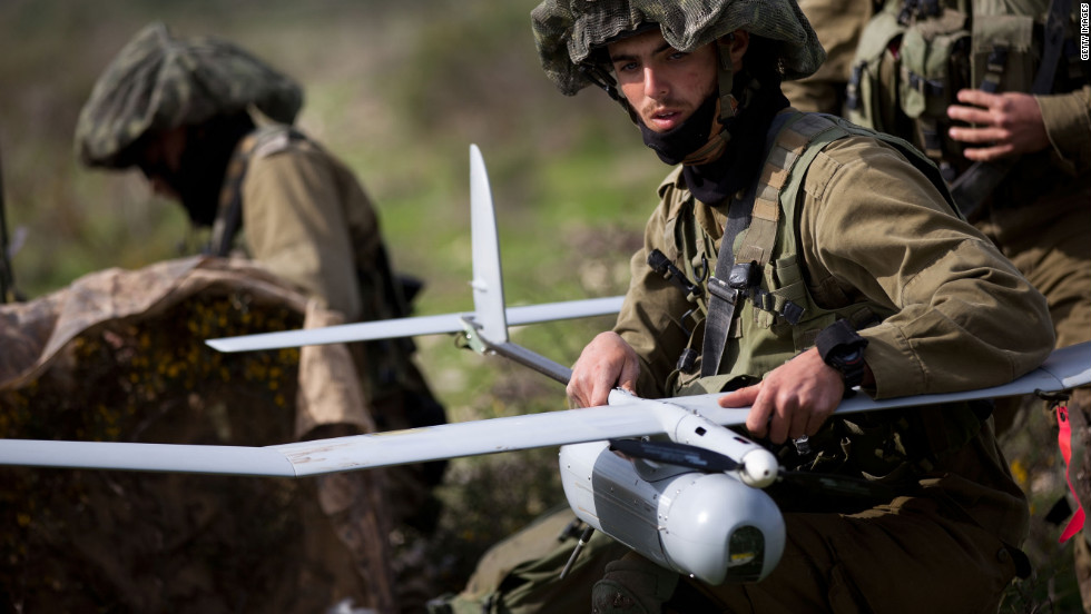 Israeli soldiers prepare to launch a Skylark drone during a drill on January 16, 2012 near Bat Shlomo, Israel. The Skylark can carry a camera payload of up to 1 kilogram, has an operational ceiling of 15,000 feet, and allows users to monitor any designated point within a 15-kilometer radius. The Skylark unit consists of a ground control element and three drones, which provide battalion-level commanders with real-time information.