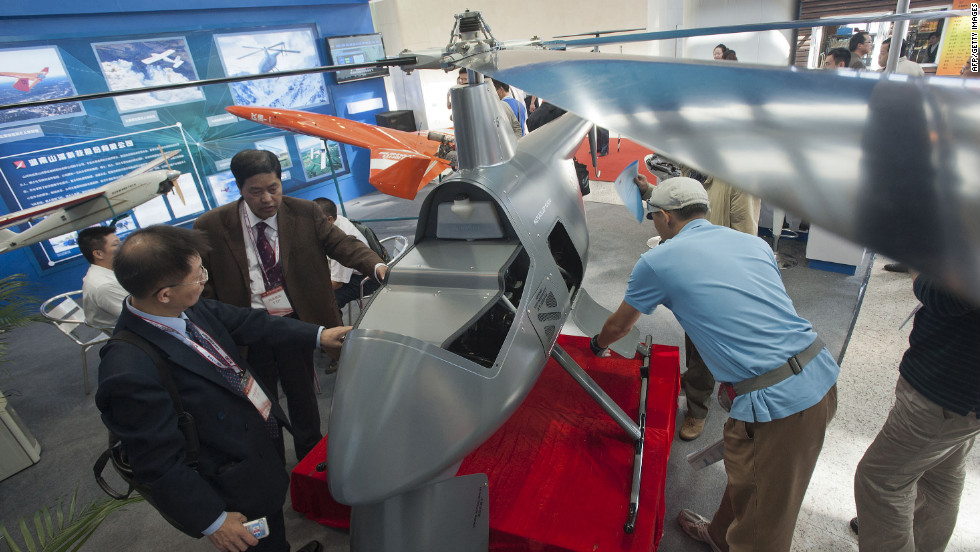 Chinese visitors examine an unmanned helicopter drone at the China Aviation Expo in Beijing on September 21, 2011.
