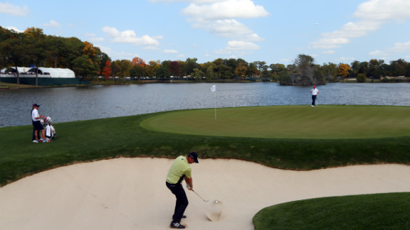Peter Hanson of Europe plays a bunker shot on the second hole during the afternoon four-ball matches on Friday.