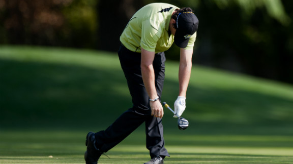 McIlroy reacts with dismay to his shot from the 10th fairway on Friday.