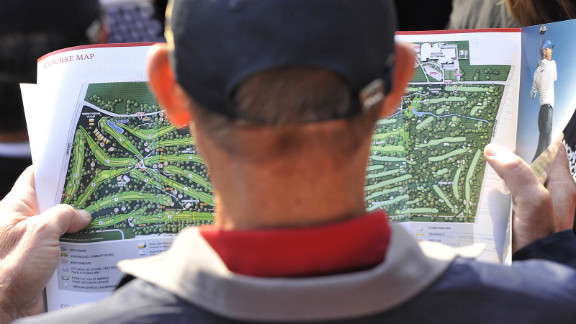 A fan looks at a map on Saturday.