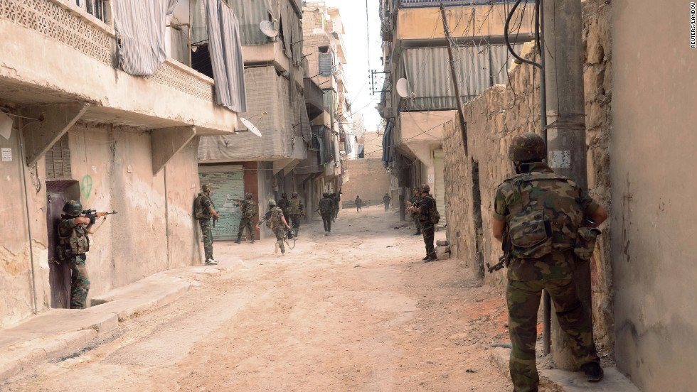 Assad forces patrol the Tal-al-Zrazir neighborhood in Aleppo on Saturday.