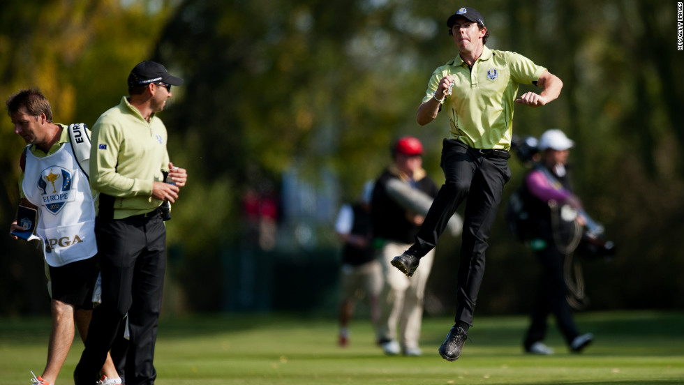 Rory McIlroy of Northern Ireland, right, jumps in the air while speaking with teammate Sergio Garcia of Spain, ssecond left, on the 10th fairway on Friday.